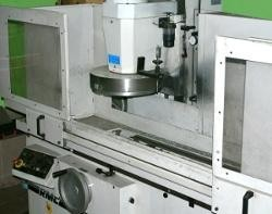 szara maszyna Socha